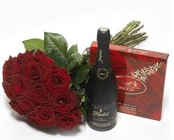 7 rose rosse LUNGHE (70/80 CM) + CIOCCOLATINI + SPUMANTE